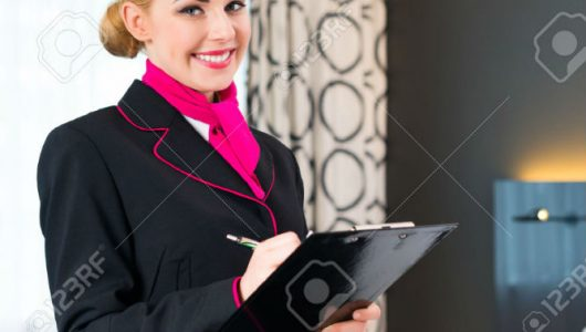 31529824-Housekeeping-manager-or-assistant-controlling-hotel-room-or-suit-with-checklist-on-tidiness-Stock-Photo